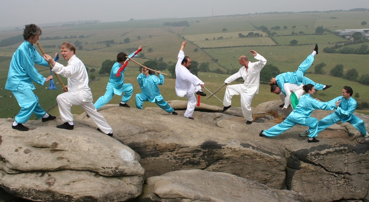 The book is enriched with related pictures, such as this which highlights how the seemingly awkward low stances of Kung Fu can help in uneven terrain